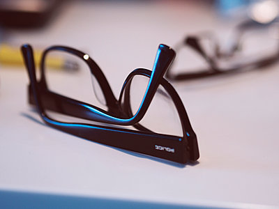 Eye Glasses on a white counter - p1072m899532 by Kevin Mallia