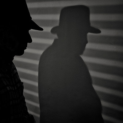 Silhouette and shadow of middle aged man - p1365m1222913 by John Heseltine