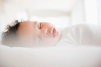 Mixed Race baby boy sleeping on bed - p555m1304484 by JGI/Jamie Grill