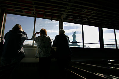 Old women in the ferry boat to the Statue of Liberty, NYC - p1028m1207186 by Jean Marmeisse