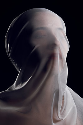 Womans' head covered by see through cloth  - p1540m2115773 by Marie Tercafs