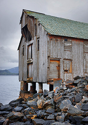 Old abandoned shed on coast - p312m714738 by Bruno Ehrs