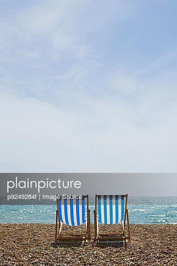 Deckchairs on brighton beach - p9249284f by Image Source