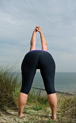 Yoga near the sea - p1132m1071984 by Mischa Keijser
