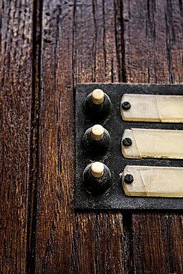 Three doorbells - p177m953063 by Kirsten Nijhof