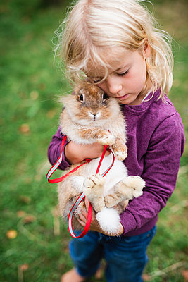 Girl hugging rabbit - p312m2086405 by Anna Johnsson
