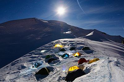 Moonlit tents on Mont Blanc, Haute-Savoie - p871m819458 by Christian Kober