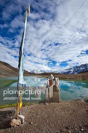 Prayer flags and Dhankar Lake, Spiti Valley, Himachal Pradesh, India