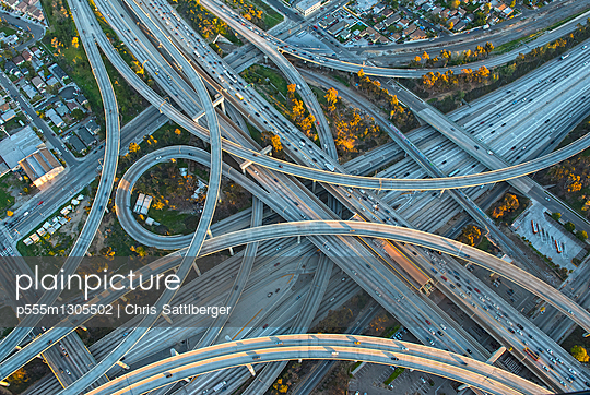 Aerial view of highway interchange in cityscape - p555m1305502 by Chris Sattlberger