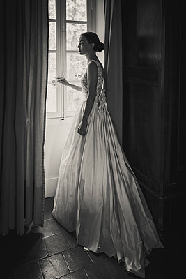pretty bride at the window - p1150m1515044 by Elise Ortiou Campion