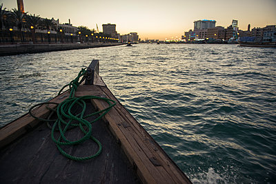 Canoe on urban canal - p555m1410086 by Aaron Greene