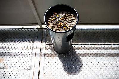 Cigarette butts in ashtray - p623m1125535f by Isabelle Rozenbaum