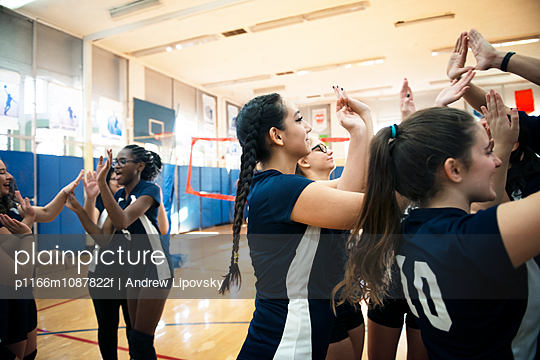 Female sports team enjoying at volleyball court