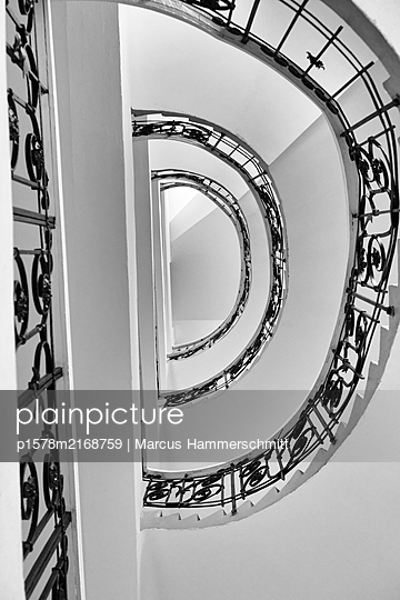 Winding staircase with ornamented handrail - p1578m2168759 by Marcus Hammerschmitt