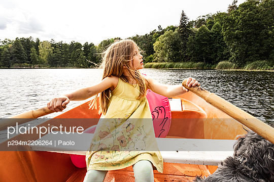 Girl in rowing boat - p294m2206264 by Paolo