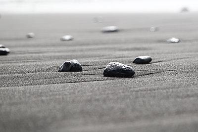 Pebble stones on a beach - p1643m2229372 by janice mersiovsky