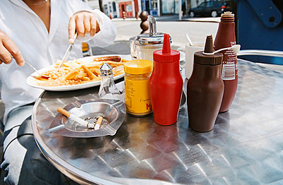 Young man eating a fried breakfast - p92410779f by Image Source
