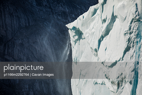 Detailed view of melting glacier, granite mountain cliff. - p1166m2292764 by Cavan Images