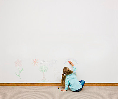 Child drawing on the wall - p4429506f by Design Pics
