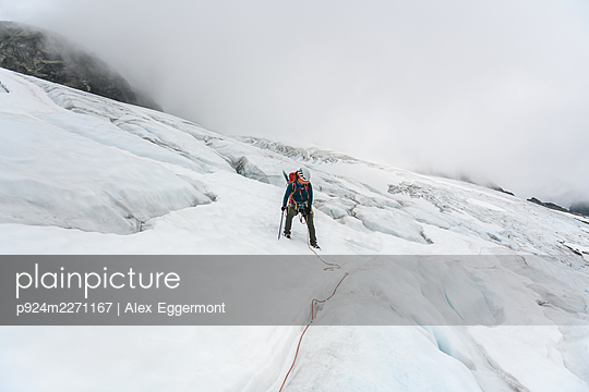 Climber on Tantalus Traverse, a classic alpine traverse close to Squamish, British Columbia, Canada - p924m2271167 by Alex Eggermont