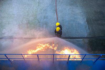 Firefighters in simulation training - p429m768900f by Monty Rakusen