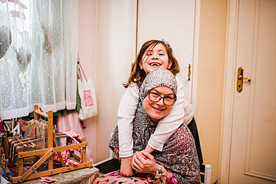 Mother with daughter together - p312m2191206 by Anna Johnsson
