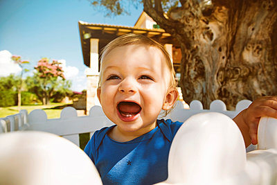 Male baby with open mouth outdoors - p300m981505f by Gabi Dilly