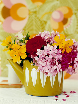 Cut flowers in retro teapot - p349m2167672 by Polly Wreford