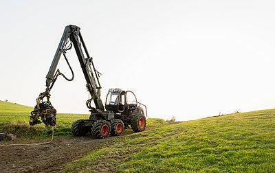 Tractor on dirt path, Meerfeld, Rheinland-Pfalz, Germany - p429m1514010 by Mischa Keijser