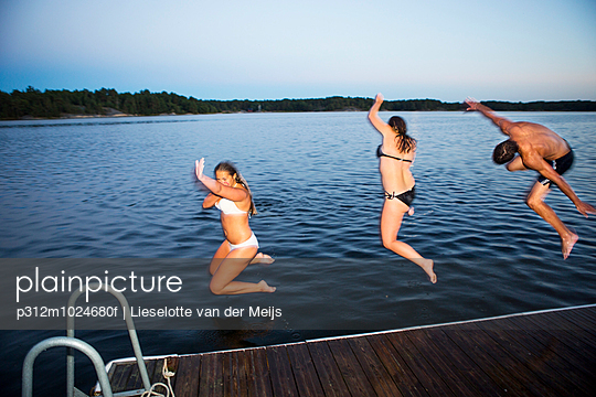 Young people jumping into water