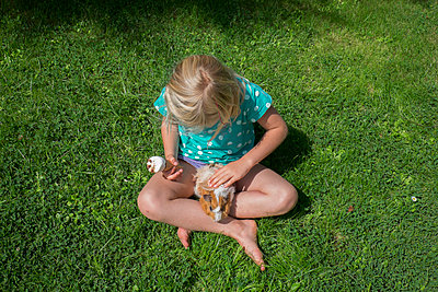 Girl with Guinea pig outside - p522m987562 by Pauline Ruhl Saur