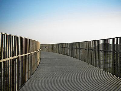 Metal railing on raised walkway - p42917062 by KMM Productions