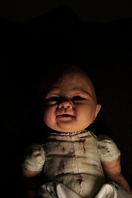 Creepy childs doll in shadows - p1072m829370 by Neville Mountford-Hoare