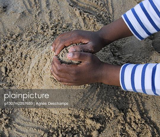Two Hands for a Sand Castle - p1307m2257659 by Agnès Deschamps