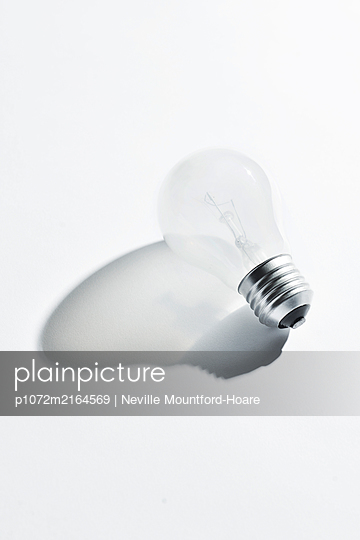 light bulb with shadow - p1072m2164569 by Neville Mountford-Hoare