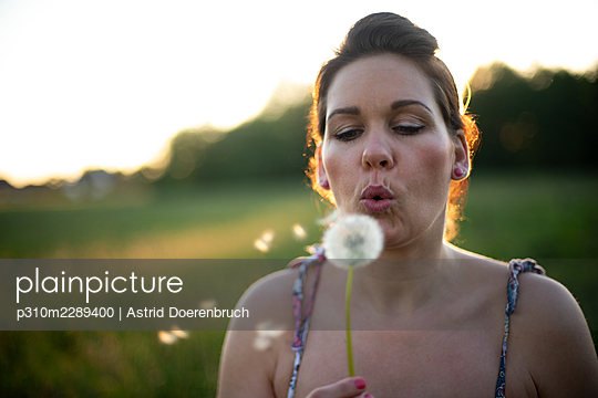 Blowing a blowball - p310m2289400 by Astrid Doerenbruch