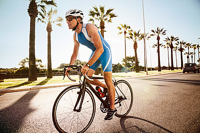 Spain, Mallorca, Sa Coma, triathlet training on bicycle - p300m1029206f by Mareen Fischinger