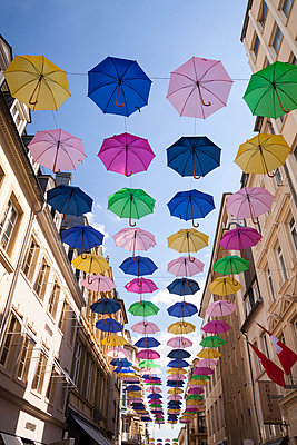 Luxembourg, Luxembourg City, Umbrellas hanging between houses of a pedestrian area - p300m950239f by Wilfried Wirth