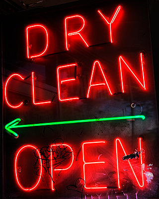 A neon sign reading Dry Clean Open with an arrow. - p343m1554736 by Ron Koeberer