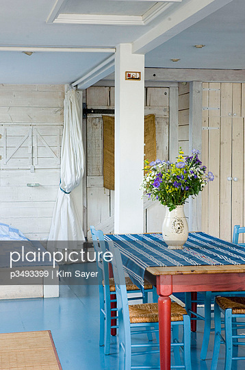 Blue painted chairs and floor in holiday home  Devon  UK - p3493399 by Kim Sayer