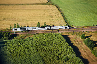Aerial view of train on tracks - p312m1210971 by Hans Berggren