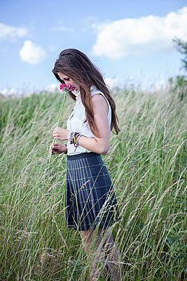Young woman on a meadow - p502m924233 by Tomas Adel
