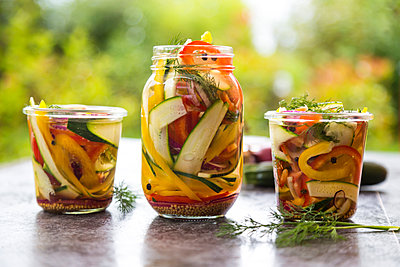 Pickeled vegetables and herbs in preserving jars - p300m1188932 by Sandra Roesch
