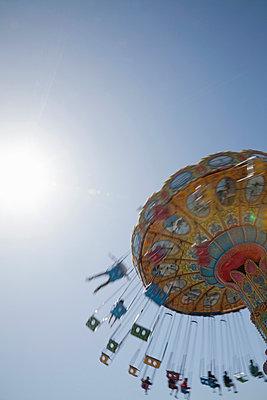 Funfair ride - p495m831557 by Jeanene Scott