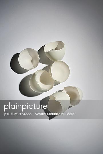 Three broken egg shells - p1072m2164583 by Neville Mountford-Hoare