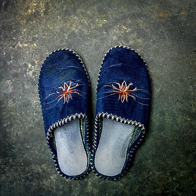 Pair of used slippers. - p813m1122816 by B.Jaubert