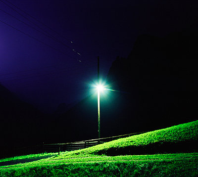 Streetlight in the swiss mountains - p1132m925525 by Mischa Keijser