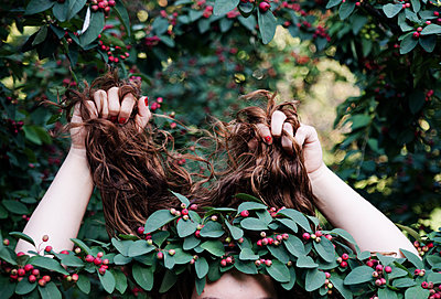 Woman hiding in berry bush  - p1229m1221106 by noa-mar