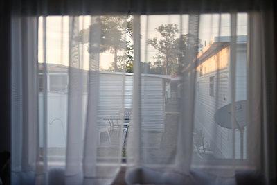 Trailer Park Window - p1335m1171627 by Daniel Cullen