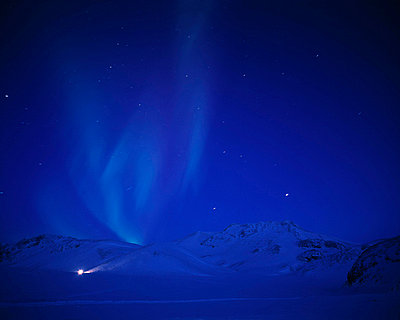 The Northern Lights shine across the winter sky - p4550400f by Kristjan Maack